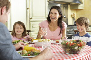 Family Eating Meal Together In Kitchen