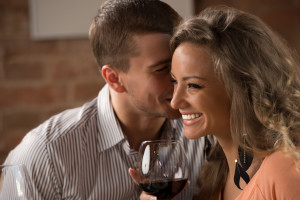 Young happy couple having romantic date at restaurant